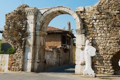 Ancient roman stone town gate in Milas, Turkey. royalty free stock photography