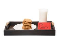 Milch und Haus machten Plätzchen für Santa Claus IV Lizenzfreie Stockfotos