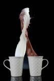 Milch- und Kaffeespritzen stockbild