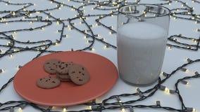 Milch und Plätzchen auf roter Platte Stockfoto