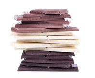 Milch-, weiße und Dunkleschokolade Stockfotografie
