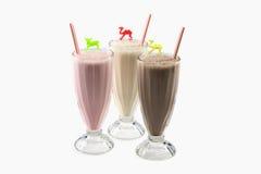 Milchshakevanille, Schokolade, Erdbeere Lizenzfreie Stockfotografie