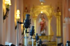 Milcophone in Mass. Music for god Royalty Free Stock Photos