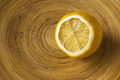 Mild Dried Lemon in a Wooden Bowl. Mild dried lemon cut in half in a wooden bowl Stock Photos