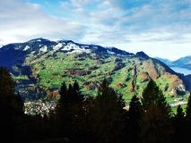 The mild slopes of the Grossberg mountain, above the Seeztal valley. Canton of St. Gallen, Switzerland royalty free stock photography