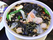 Mild soup with seaweed and minced pork. Mild soup with seaweed and minced pork in Thailand royalty free stock image