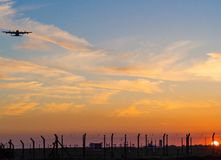 Mildenhall Airbase at sunset. Military airplane flying low over the air base in sunset at Mildenhall suffolk Stock Photo