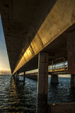 7 mile brigde sunset. Long shot under the 7 mile bridge with the Atlantic ocean meeting the gulf of Mexico at high tide and golden sunset Royalty Free Stock Photo