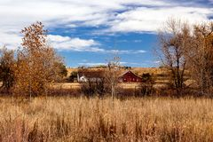 17 Mile Farm Park in Fall Red Barn. Red barn in fall at 17 Mile Farm Park in Aurora, Colorado royalty free stock images