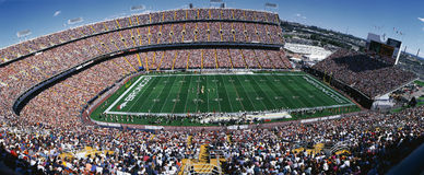 Mile High Stadium. This is Mile High Stadium with the Denver Broncos playing the St. Louis Rams to a sold out crowd. This was an NFL game that took place on 9/14