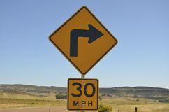 30 mile per hour right turn ahead Stock Photography