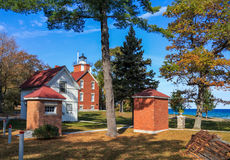 40 Mile Point Lighthouse on Lake Huron. The 40 Mile Point Lighthouse and it's out buildings as it looks toward Lake Huron on a lazy autumn afternoon, Rogers Stock Image