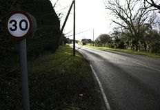 30 Mile Speed Limit in English Village on country road royalty free stock photos