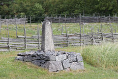 Mile stone in farm land Stock Images
