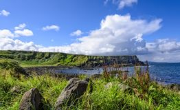 Antrim Coastline in Northern Ireland. The 20-mile stretch of the Antrim Coastline extending eastward from Portrush to Ballycastle, and includes Giants Causeway royalty free stock photo