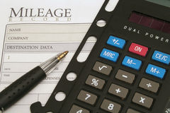 Mileage log & calculator. Shot of a mileage log & calculator Stock Image
