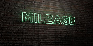 MILEAGE -Realistic Neon Sign on Brick Wall background - 3D rendered royalty free stock image. Can be used for online banner ads and direct mailers Royalty Free Stock Photography