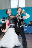 Milehin Matvej en Dyavgo Dariya Perform jeugd-1 Standaardprogramma Stock Foto