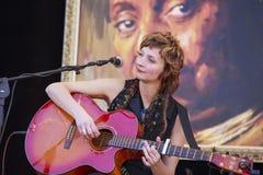 Milena Piazzoli playing guitar Stock Photos