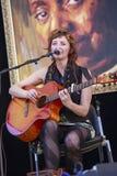 Milena Piazzoli playing guitar Stock Image