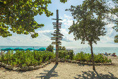 Milepost on beach in Key West Florida Stock Photo