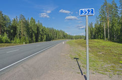 Milepost on the federal highway A121. Karelia, Russia. Royalty Free Stock Image