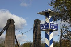 Milepost with names of the cities in Russian and distance in kilometers Royalty Free Stock Photo