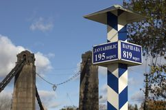 Milepost with names of the cities in Russian and distance in kilometers Stock Images