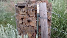 Lava rock supports fence and post royalty free stock photos