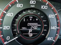 99,999 Miles on Odometer. 1 Mile before car odometer turns to 100,000 miles Stock Photography