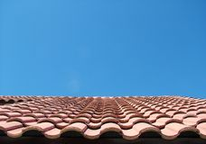 Miles of Tiles. Red tile roof against bright blue sky royalty free stock photo