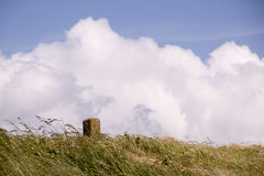 Milestone. Mile stone at a dike in Holland Royalty Free Stock Images