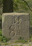 Milestone on canal towpath. Milestone marker 8 1/4 miles on Bolton-Bury-Manchester canal towpath, Lancashire Royalty Free Stock Image