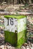 Milestone No. 16. A White and green Milestone on the street in the Spessart with moss Royalty Free Stock Photography