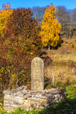 Milestone in a pasture at autumn Royalty Free Stock Images