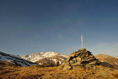 Milestone in the Pyrenees. With snowed mountains at the background royalty free stock photo