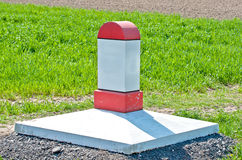 Milestone. Red and white milestone in a rural field royalty free stock photo