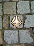 Milestone in shape of a shell inserted in the pavement. Brussels stock images
