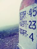 Milestone. Showing distance of nearby villages from chanshal pass stock photos