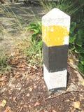 Milestone. Yellow and black stripe milestone Royalty Free Stock Image