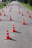 Road cones with reflective band. On the alley Royalty Free Stock Image