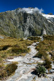 Milford Pass Monument. Mountain path with monument, Milford Track, New Zealand Royalty Free Stock Photography