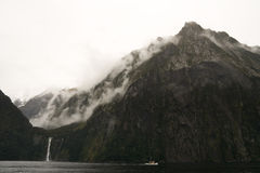 Milford sound. Boat cruise past cliffs in beautiful milford sound Stock Image