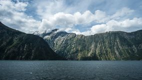Milford Sound Cliff Wall. Look at the damage left over from the glaciers thousands of years ago stock photos