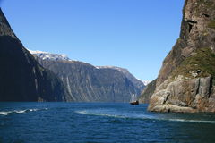Milford Sound, New Zealand. A tourist boat in Milford Sound, New Zealand Royalty Free Stock Photography