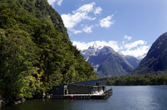 Milford Sound - New Zealand. MILFORD SOUND,NZ - JAN 14:Milford Discovery Center on Jan 14 2014.It's New Zealand's only floating underwater observatory,descend 10 Royalty Free Stock Photos