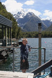 Milford Sound,New Zealand. Boy on wharf,Harrison Cove,Milford Sound, New Zealand stock photography
