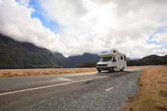 MILFORD SOUND NEW ZEALAND-AUGUST 30 : camper van on the road to Stock Image