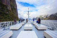 MILFORD SOUND NEW ZEALAND-AUGUST30 : visitor on the roof of sea Stock Photography