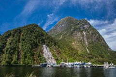 Southern Discoveries at Milford Sound. Milford Sound, New Zealand - December 18, 2017: Southern Discoveries -touristic attraction- Fjord Cruises starting point Royalty Free Stock Photos
